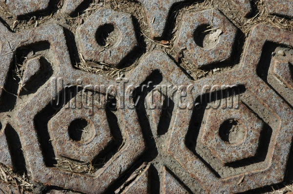 manhole hexagon pattern shadow dirty weathered industrial metal dark brown