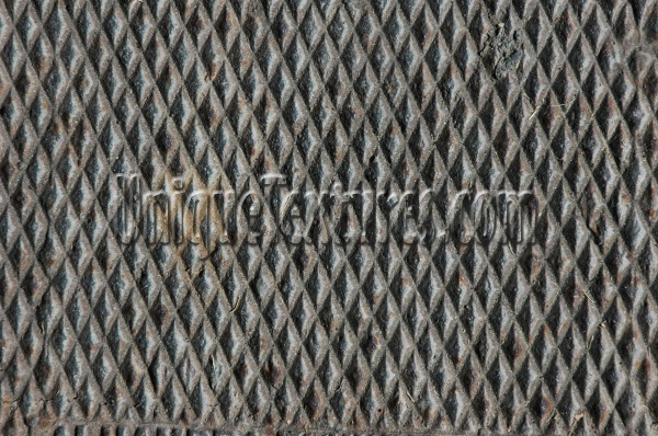 manhole diamonds pattern shadow rusty industrial metal dark brown gray