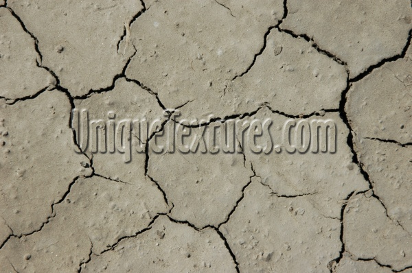 cracked/chipped weathered natural earth tan/beige floor