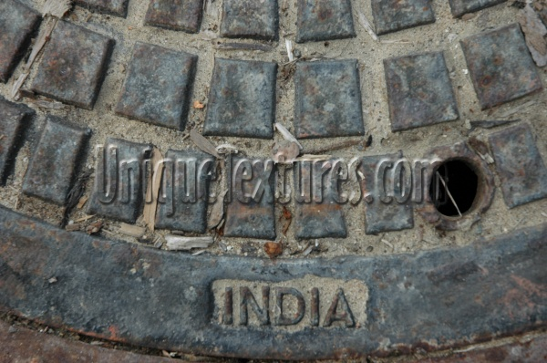 manhole pattern textual industrial metal gray