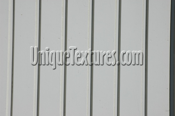vertical pattern grooved architectural wood boards fence paint white