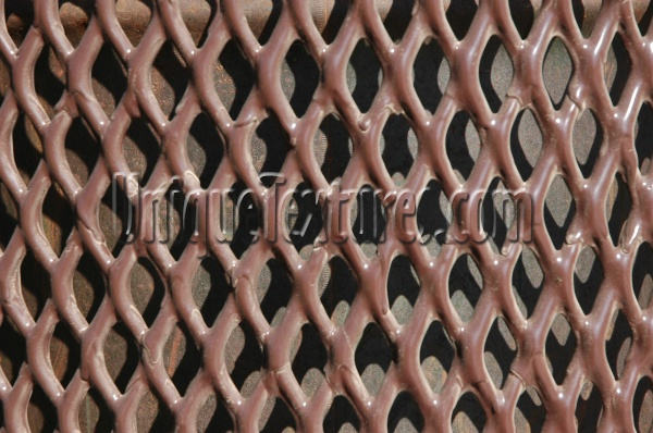 vent/drain pattern shadow industrial metal dark brown