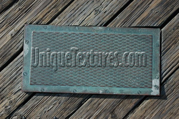 manhole diamonds pattern grooved weathered industrial metal gray