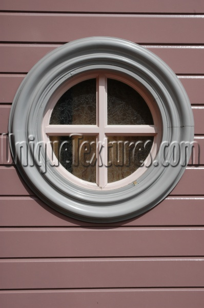 gray multicolored glass wood architectural round window