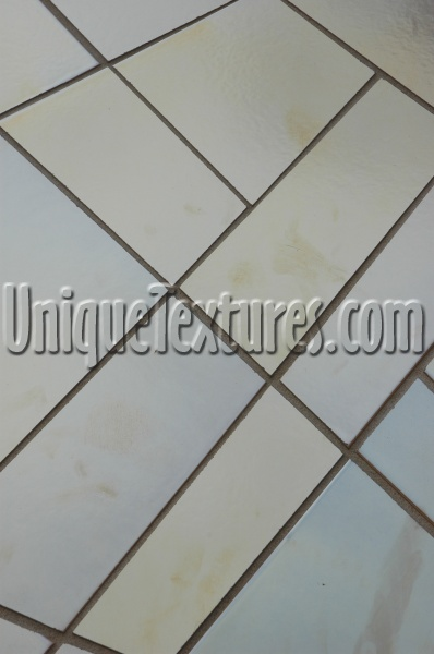 white tile/ceramic architectural shiny angled wall