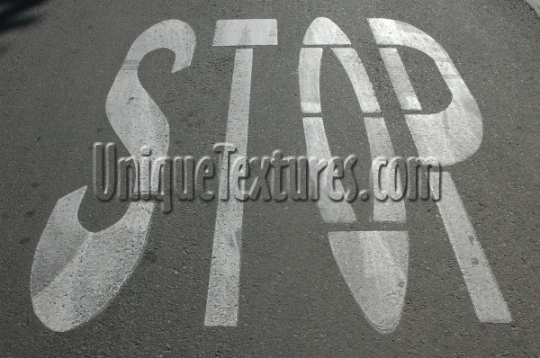 street sign oblique textual vehicle     asphalt paint white black