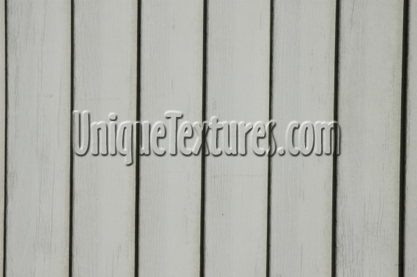white wood architectural grooved vertical fence boards