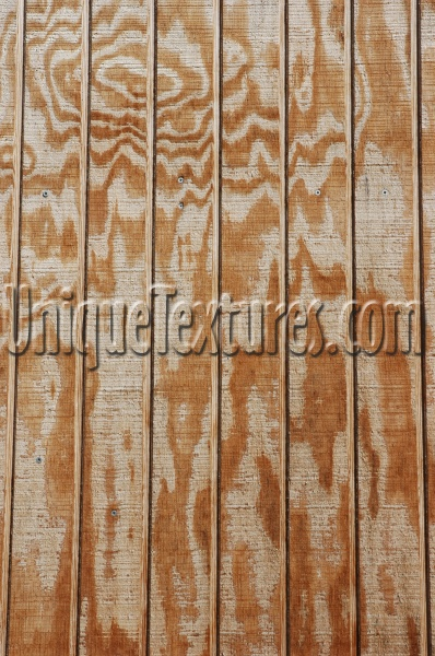 plywood    fence vertical grooved architectural wood tan/beige