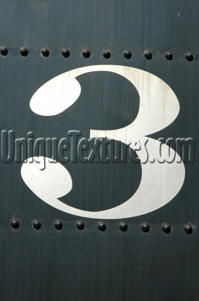 sign curves  numerical stained        paint white black vehicle industrial metal