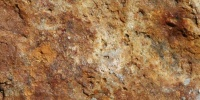 rough architectural natural stone dark brown