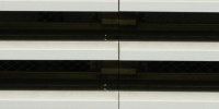 window vent/drain horizontal pattern shadow industrial architectural metal white black