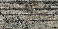 weathered architectural wood dark brown