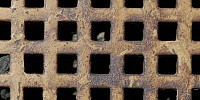vent/drain square pattern rusty industrial metal dark brown multicolored black