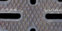 vent/drain pattern industrial metal dark brown