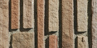 fence wall rectangular shadow architectural brick stone dark brown