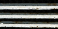 vent/drain horizontal shadow weathered industrial metal gray