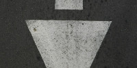 street symbol vertical        triangular vehicle asphalt white