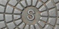 manhole pattern textual shiny industrial metal metallic