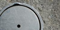 door manhole round shiny industrial metal concrete metallic gray