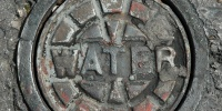 manhole round textual industrial metal gray