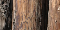 fence vertical weathered architectural wood dark brown