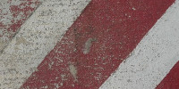 red white multicolored paint concrete vehicle scratched angled symbol street