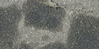 gray asphalt vehicle stained random spots street