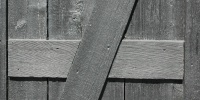 black paint wood architectural angled fence boards
