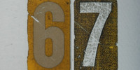 sign numerical cracked/chipped weathered scratched mech/elec metal paper multicolored