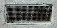 gray metal stucco/plaster architectural rectangular vent/drain