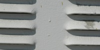 white paint metal industrial shadow horizontal vent/drain