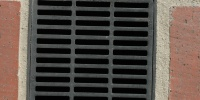 street vent/drain square pattern industrial architectural metal brick gray