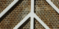 tan/beige white metal architectural rusty pattern angled fence