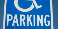 blue white paint metal vehicle textual sign symbol