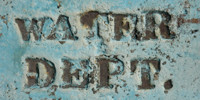 blue paint metal industrial bleached scratched weathered textual sign manhole