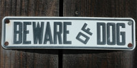 black white metal wood architectural textual sign