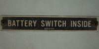 gray metal industrial mech/elec textual rectangular horizontal sign