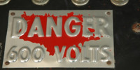 red metallic metal industrial mech/elec scratched textual numerical sign