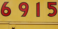 yellow red vibrant paint metal industrial numerical sign