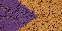 symbol wall triangular rough architectural stucco/plaster paint purple yellow