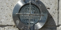 gray metallic concrete metal mech/elec shiny round wall fixture